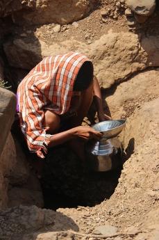 Girl filling water