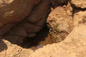 Pit dug up by women for water