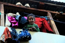 A kid at Malana who got excited looking at me with a DSLR :D